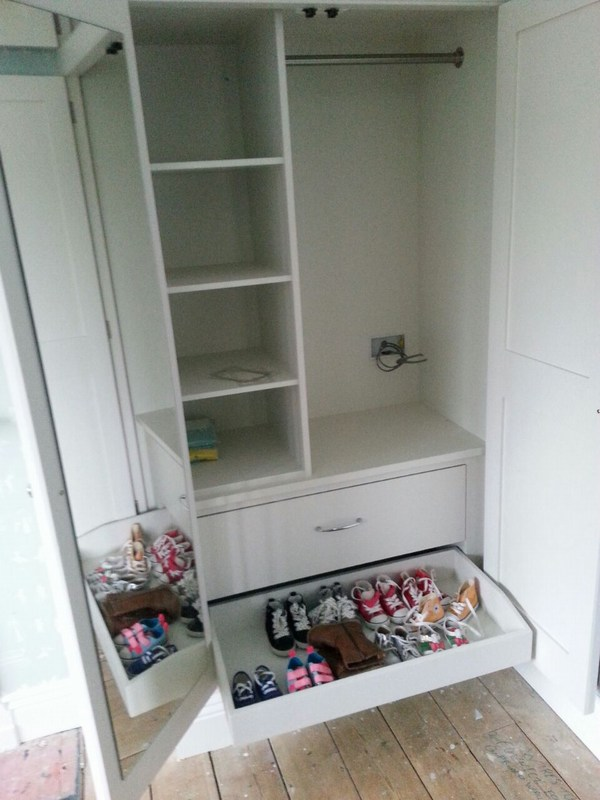 Bespoke alcove wardrobes in Ware, Hertfordshire. Right hand unit with mirror, shoe trays and fixed shelves.