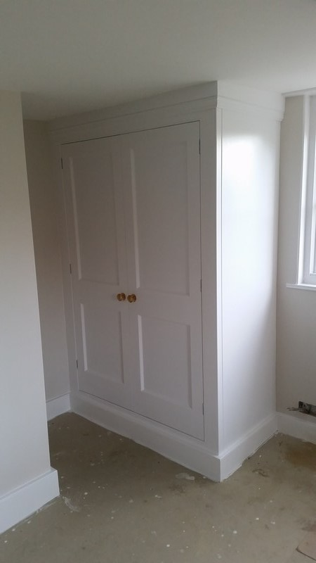Traditional wardrobes at period property in North Kent. Both wardrobes with one rail, shoe trays and wardrobe lights